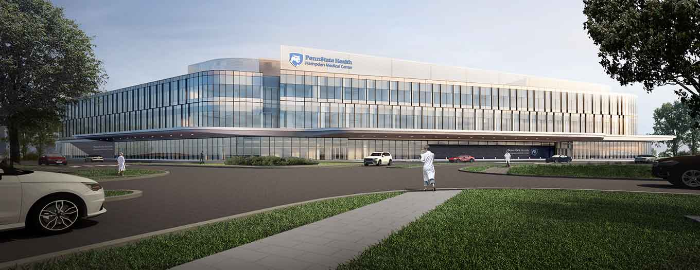 An artist rendering designed in pastel colors shows the front of a three-story building with glass lined walls filling the frame, with simple green trees to either side of the building in the foreground and several cars and people passing in front at the center. The building has a blue logo at the top of the building in the center, which says Penn State Health Hampden Medical Center.
